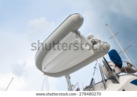 Inflatable dingy boat setup behind of the yacht for transportation