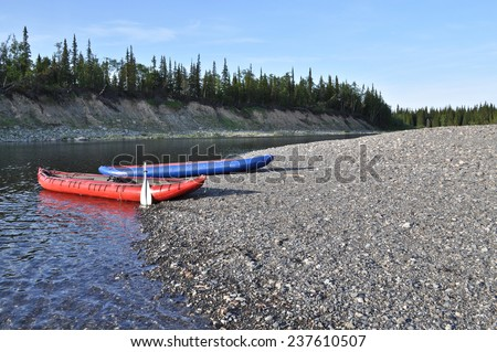 Inflatable kayaks on the shore taiga rivers. The river of the polar Urals in the Republic of Komi, Russia.