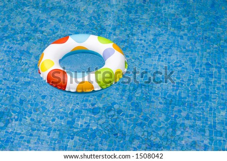 inflatable on pool - stock photo