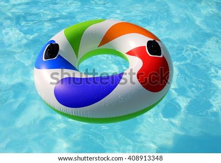 inflatable on pool - stock photo