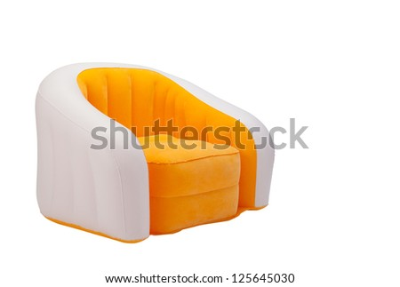 Inflatable orange color armchair isolated on white  background - stock photo