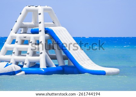 Inflatable slide at a Caribbean Island resort - stock photo