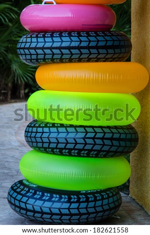 Inflatable Tubes/ Tubes/ A stack of Tubes wait for some swimmers who want to float. - stock photo