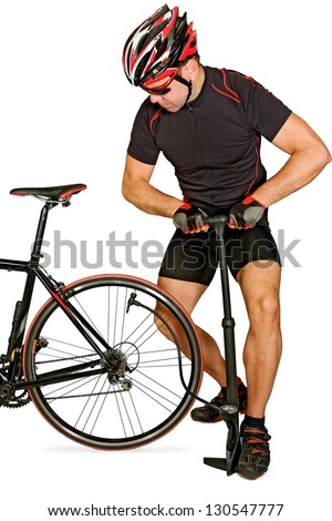Inflating the tire of a bicycle. Cyclist repairs bike. Bicyclist pumping air into the wheel. Biker uses a bicycle pump. Pumping air into an empty wheel of bike isolated on white background.
