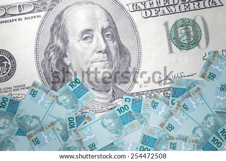 Inflation Brazilian real against the backdrop of the US dollar - stock photo