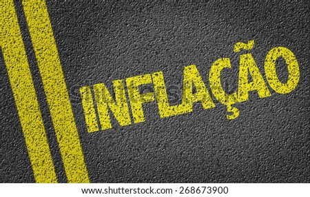 Inflation (in Portuguese) written on the road - stock photo