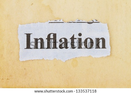 inflation newspaper cutout in an old paper background.