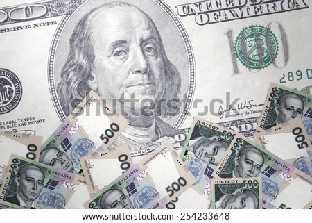Inflation Ukrainian hryvnia against the backdrop of the US dollar - stock photo