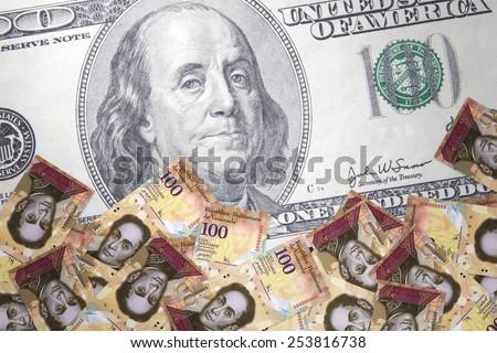 Inflation Venezuelan bolivar against the backdrop of the US dollar - stock photo