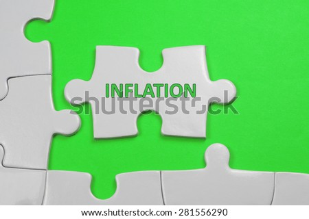 Inflation word on white puzzle - Business Concept - stock photo