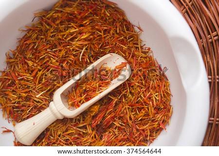 Inflorescence of saffron in a ceramic mortar and expensive spice saffron. - stock photo