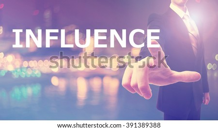 Influence concept with businessman on blurred city background