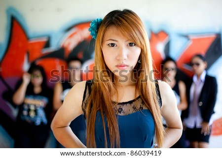 Influential women and her gang in a graffiti painted. - stock photo