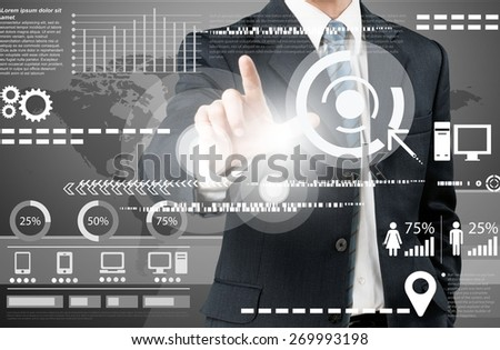 Information. Businessman works with huge touch screen - stock photo
