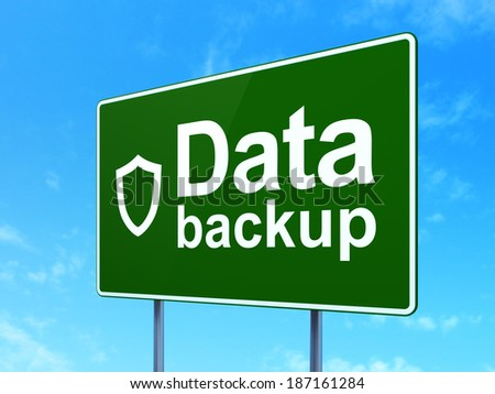 Information concept: Data Backup and Contoured Shield icon on green road (highway) sign, clear blue sky background, 3d render - stock photo