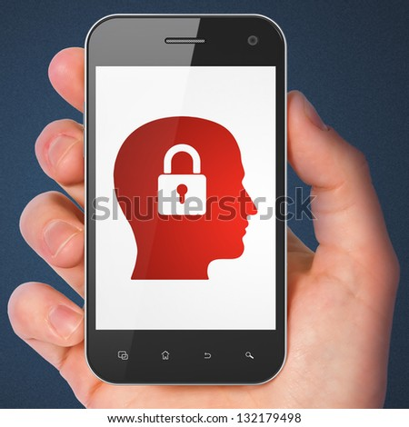 Information concept: hand holding smartphone with Head Whis Padlock on display. Generic mobile smart phone in hand on Dark Blue background. - stock photo