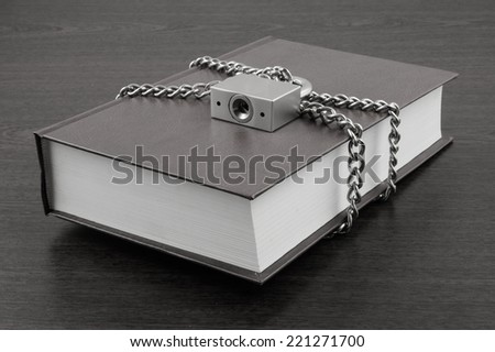 Information security concept, book with chain and padlock  - stock photo