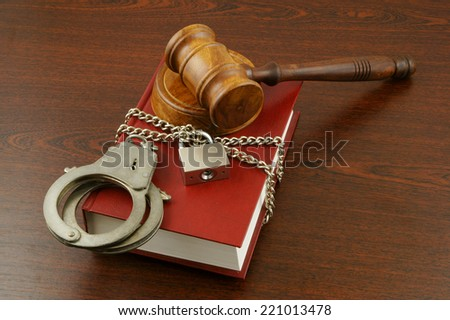 Information security concept, gavel, book with chain and padlock - stock photo