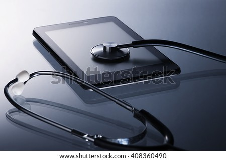 Information technology security Concept-stethoscope checing on smartphone - stock photo