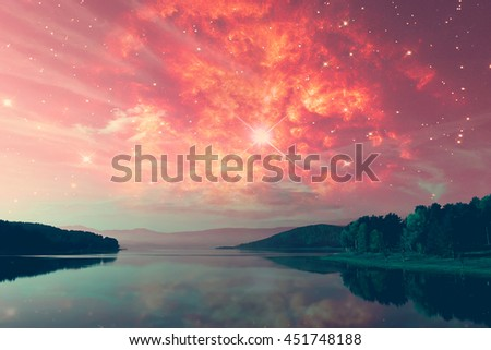 infrared landscape with red alien sky with manny stars over the mysterious lake- elements of this image are furnished by NASA - stock photo