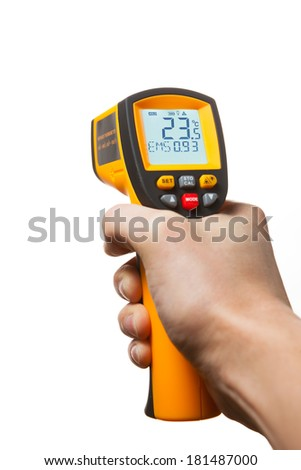 infrared laser thermometer in hand isolated on white - stock photo