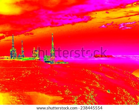 Infrared photo of Alpine winter hilly landscape. Sunny weather with clear sky above. Amazing thermography colors. - stock photo