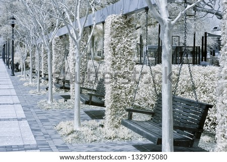 infrared photo of park with swing benches