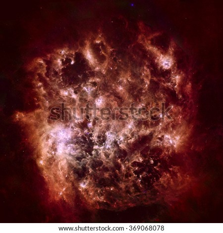 Infrared Portrait of the Large Magellanic Cloud. Cosmic dust clouds ripple across our Milky Way's satellite galaxy, the Large Magellanic Cloud. Elements of this image furnished by NASA. - stock photo