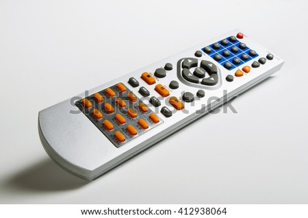 infrared TV remote control on white background - stock photo