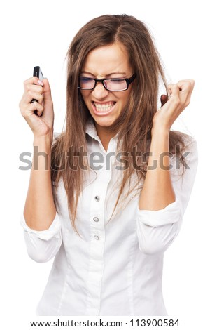 Infuriated woman with cellphone against white background - stock photo