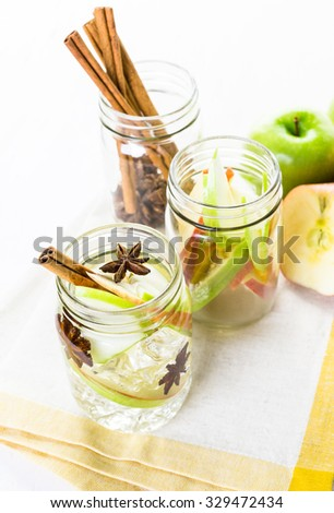 Infused apple water with cinnamon and anise.