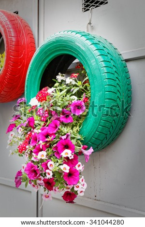 Ingenious, original and environmentally friendly method of recycling of tires car - stock photo