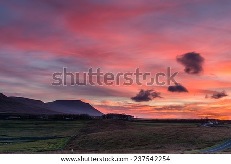 Ingleborough at sunset / Ingleborough is the second highest mountain in the Yorkshire Dales and is one of the Yorkshire Three Peaks - stock photo