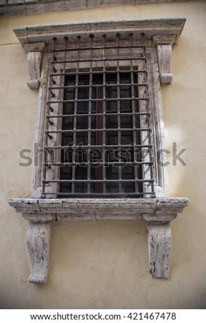 Inglese     ItalianoOld window with bars - stock photo