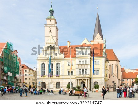 INGOLSTADT, GERMANY - OKTOBER 3: Tourists at the historic town hall of Ingolstadt, Germany on Oktober 3, 2015. Foto taken from Moritzstrasse with view to the town hall.
