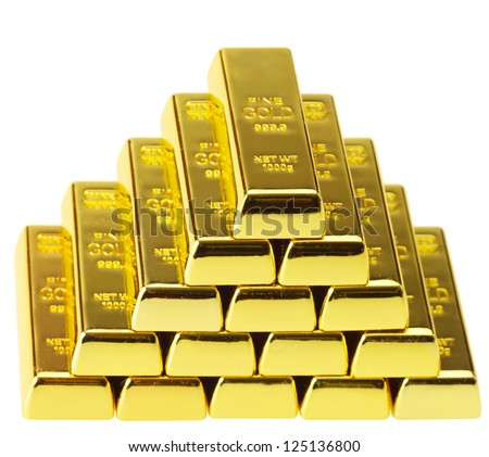 ingots of gold combined by a pyramid - stock photo