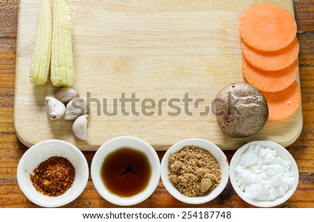 ingredient and some vegetable on table - stock photo