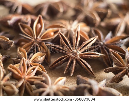 ingredient flavor aromatic- Close up  Star anise on wooden chopping block - stock photo