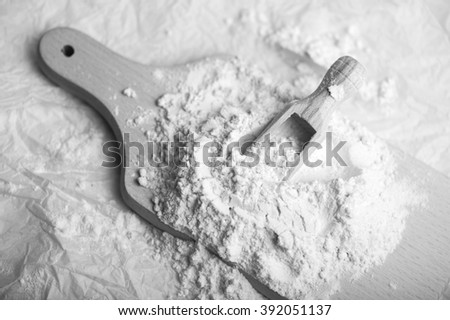 Ingredient for cooking baking - flour on wooden table. black and white image