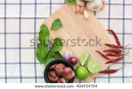 ingredient for cooking, lemon, lime, garlic, kaffir lime leave,  Red onion on wooden cutting board. - stock photo