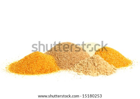 Ingredient for cooking - maize meal, crackers, manna-croup and peeled barley in a pile on white background. - stock photo