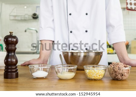 ingredient preparation by chef for making of tuna spread sandwich - stock photo