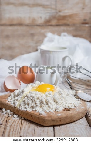 ingredients and equipment for dough - wheat flour, egg, cream, salt, whisk - stock photo