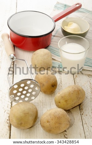 ingredients and kitchen tools to make mashed potatoes - stock photo