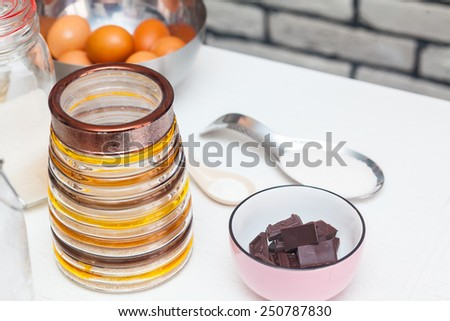 ingredients and tools to make a cake in the kitchen - stock photo