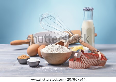 ingredients and tools to make cookies, flour, butter, sugar,egg, milk - stock photo