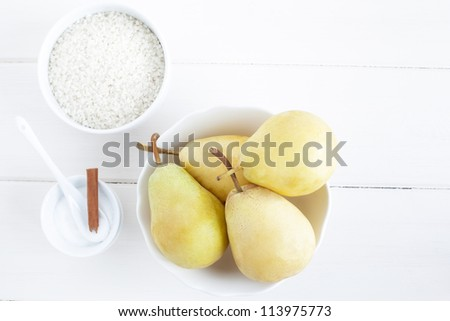 Ingredients for a rice pudding dessert: pears, rice pudding, sugar.