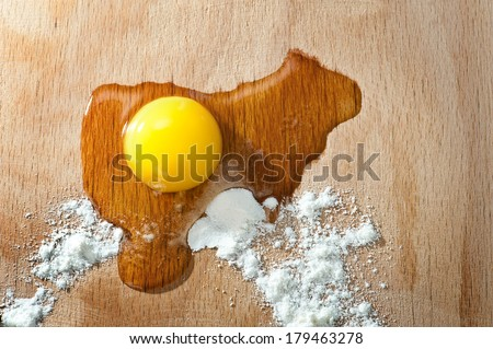 Ingredients for backing with egg and flour on a cutting board  - stock photo