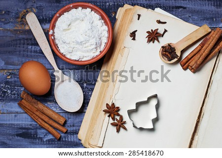 Ingredients for baking and old empty recipe book. Selective focus, space for text, top view - stock photo