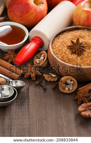 ingredients for baking apple pie and wooden background, vertical, close-up - stock photo
